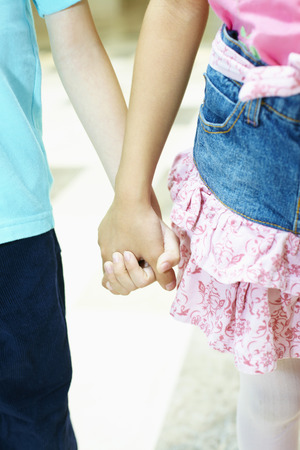 two person only: Boy and girl standing hand in hand