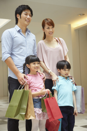 Family carrying shopping items