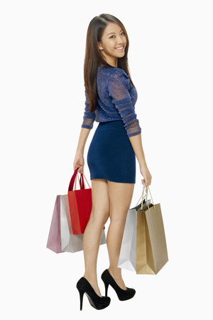 spending full: Woman carrying shopping bags