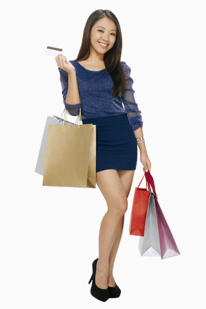 spending full: Woman with credit card and shopping bags