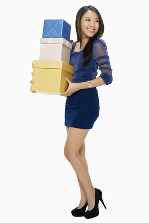 spending full: Woman carrying a stack of boxes