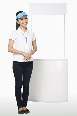 Woman standing beside a booth