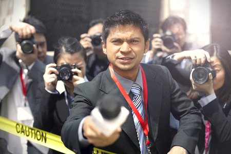 Journalist with a group of camera men