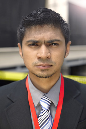 spiky hair: Journalist frowning at the camera LANG_EVOIMAGES