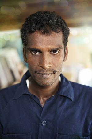 collared shirt: Man smiling at the camera