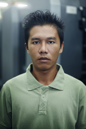 collared shirt: Portrait of a man looking at the camera
