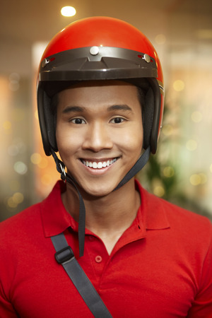 Man with helmet smiling at the camera LANG_EVOIMAGES