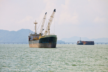 industrial noise: Cargo ships sailing across the sea