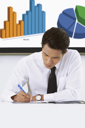 western script: Businessman writing down notes LANG_EVOIMAGES