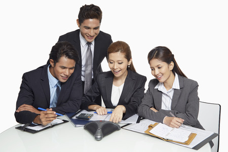 teleconference: Businessmen and businesswomen having a teleconference call