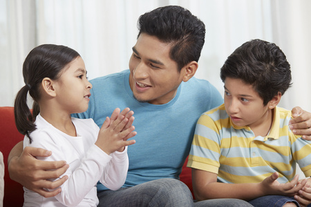 Father talking to his children Stock Photo