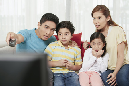 Parents and children watching television