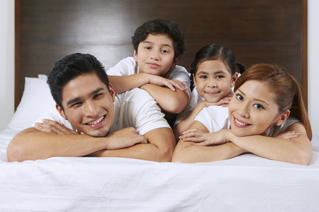 Happy and cheerful family smiling  Stock Photo
