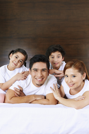 pre adolescent boys: Happy and cheerful family smiling  LANG_EVOIMAGES
