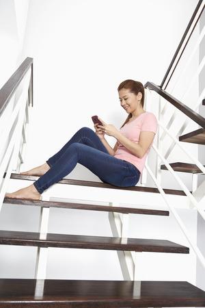 text messaging: Cheerful woman text messaging