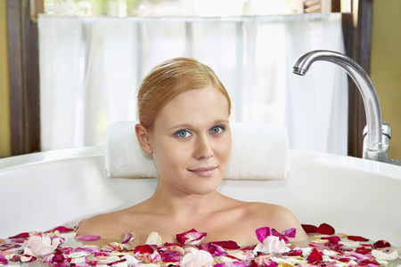 russian ethnicity: A young woman having a flower bath