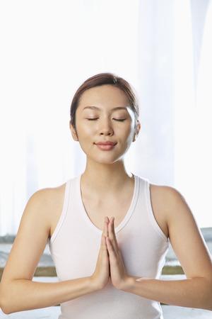A young woman meditating