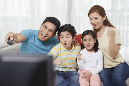 malay ethnicity: Parents and children watching television