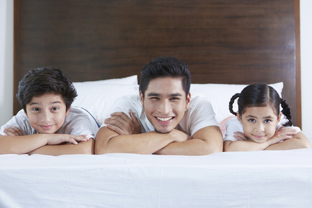 pre adolescent boys: Cheerful family smiling at the camera LANG_EVOIMAGES