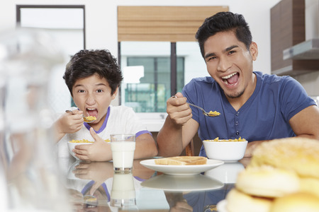one family: Father and son eating cereals