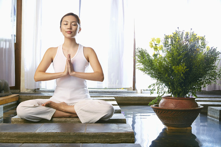 woman meditating: A young woman meditating