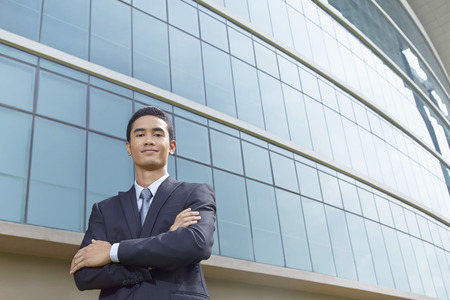 Cheerful businessman thinking