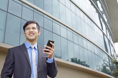 Businessman holding a phone 免版税图像