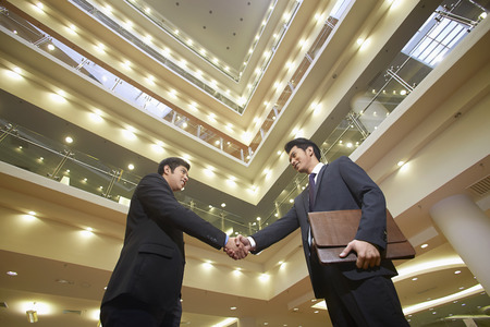 two person only: Businessmen shaking hands