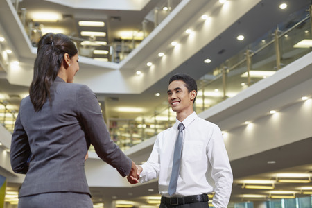 Business associates shaking hands Stock Photo