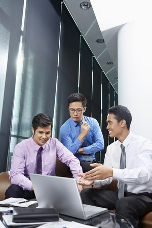 only three people: Business partners having a discussion LANG_EVOIMAGES