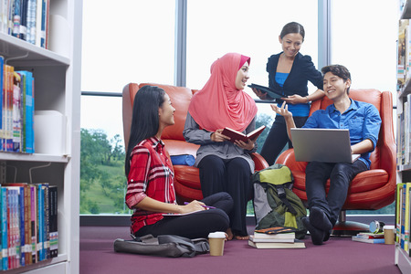 Students having study group in library 스톡 콘텐츠