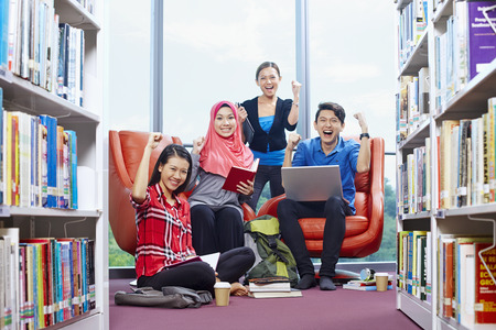 Students having study group in library Stock Photo