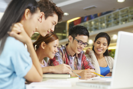Students having study group in library Standard-Bild