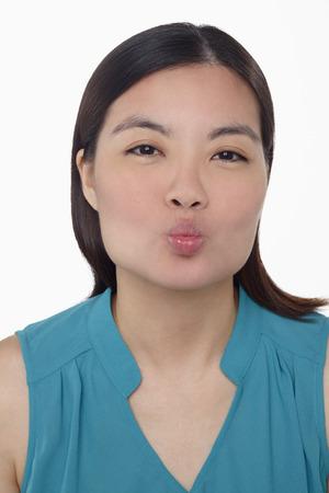 puckering lips: Facial expressions
