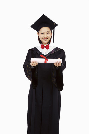 Woman in graduation robe holding scroll