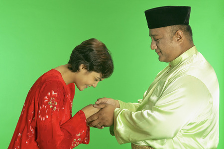 Malay woman greeting Malay man Stock Photo
