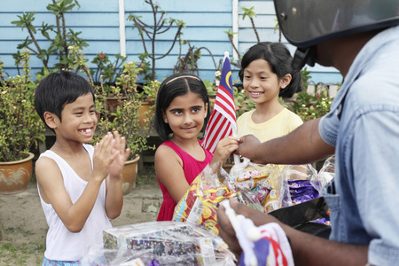 Breadman giving girl a national flag, boy and girl watching
