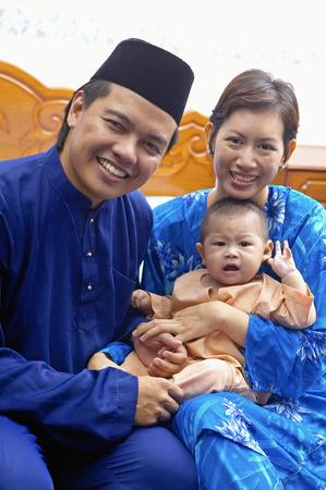 Malay family in traditional baju melayu