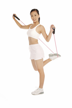 Young woman exercising with resistance band