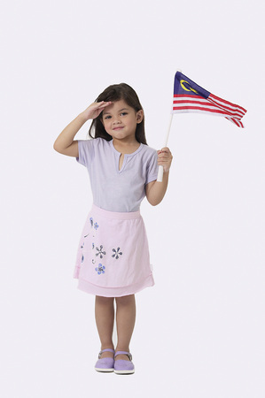 Young Malay girl holding Malaysian flag