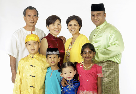 Multi-racial Malaysian families and friends in traditional clothes