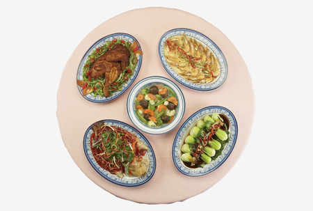 Top view of Chinese dinner dishes laid on table