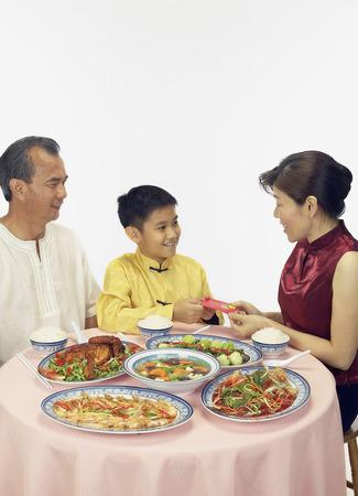 Chinese family having dinner