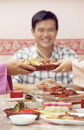 Guests enjoying feast on Hari Raya open house