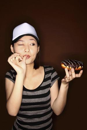 Woman holding doughnut Stock Photo