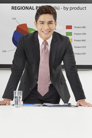 Businessman smiling at the camera