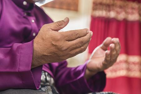 Muslim man saying prayers