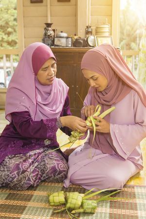 Muslim women weaving ketupat