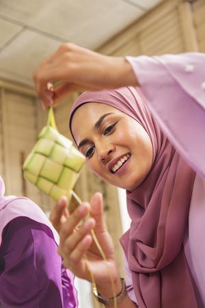 Muslim woman with ketupats