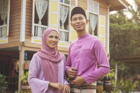 Mid adult Muslim couple standing outdoors